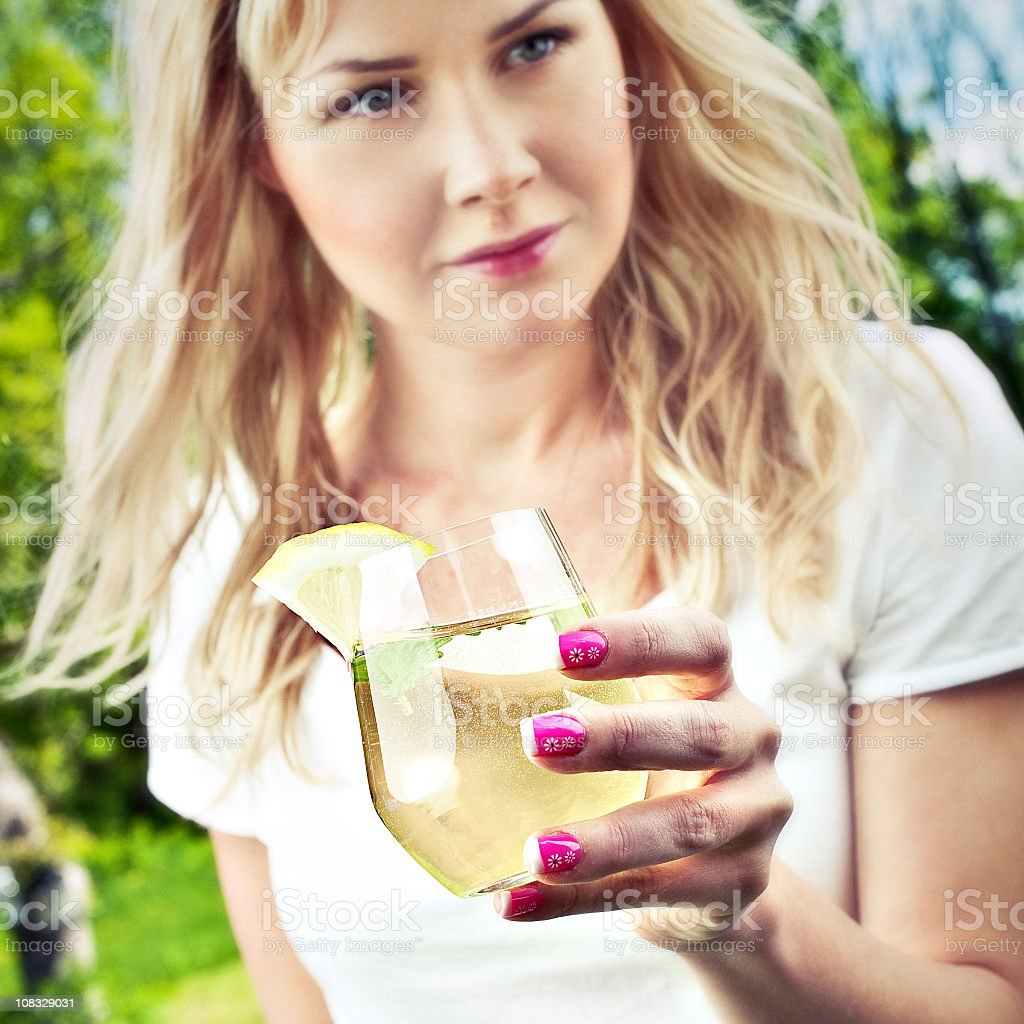 Woman holding a glass of lemonade stock photo