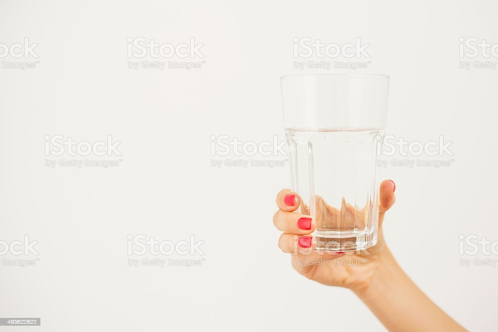 Woman holding a glass of water stock photo