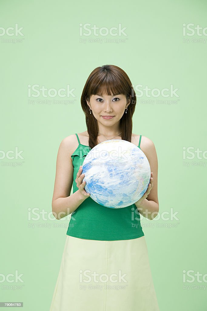 A woman holding a globe royalty-free stock photo