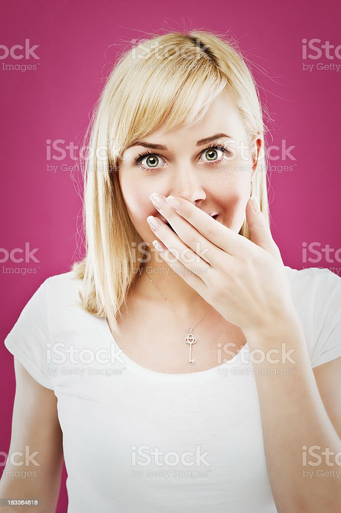 woman holding a hand over her mouth royalty-free stock photo