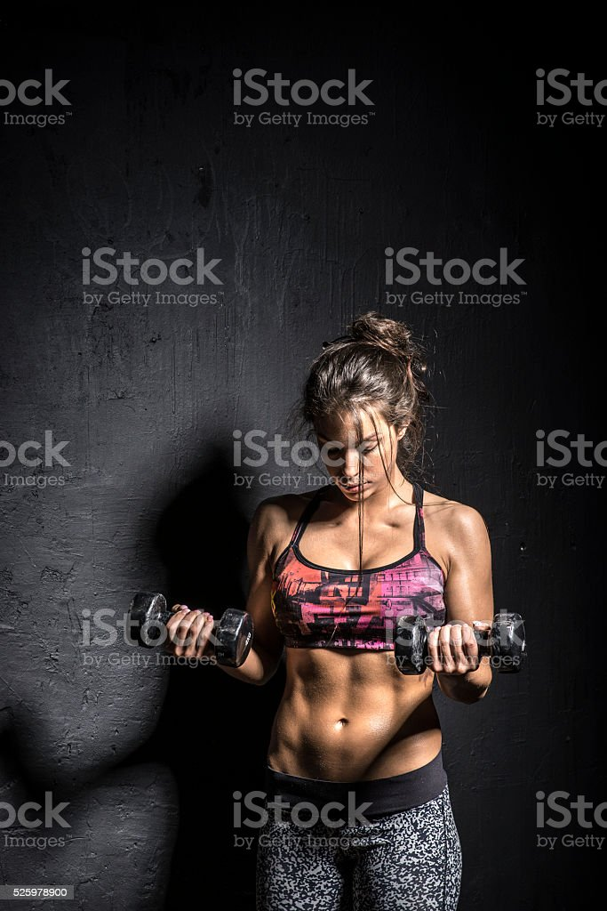 Woman holding a hand weight stock photo