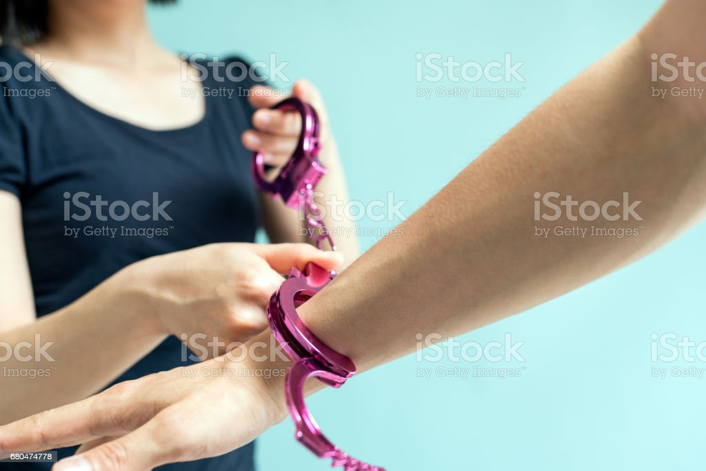 Woman holding a handcuff stock photo