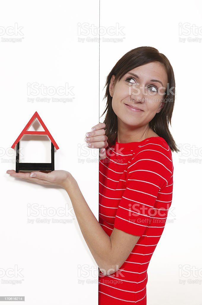 woman holding a house shape royalty-free stock photo