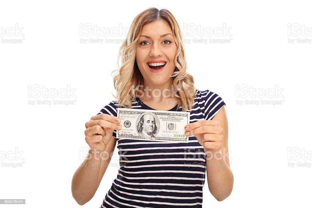 Woman holding a hundred dollar bill stock photo
