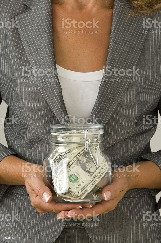 Woman holding a jar with money royalty-free stock photo