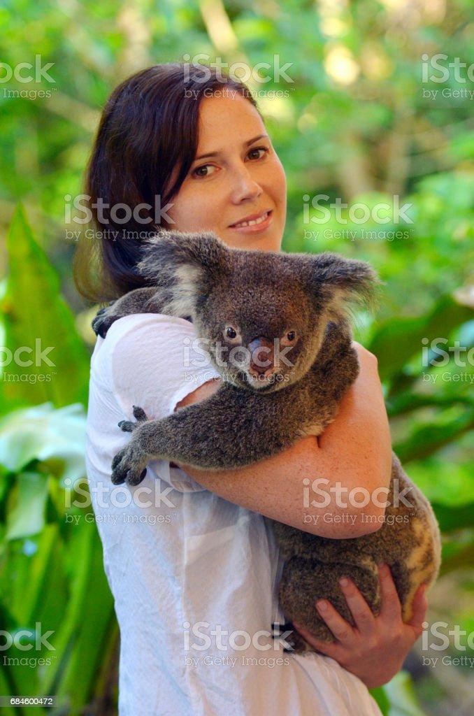 Woman holding a Koala stock photo