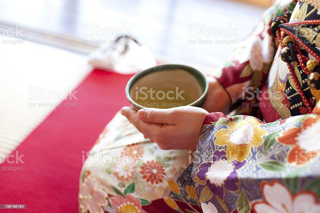 Woman holding a large tea cup for the Japanese tea ceremony stock photo