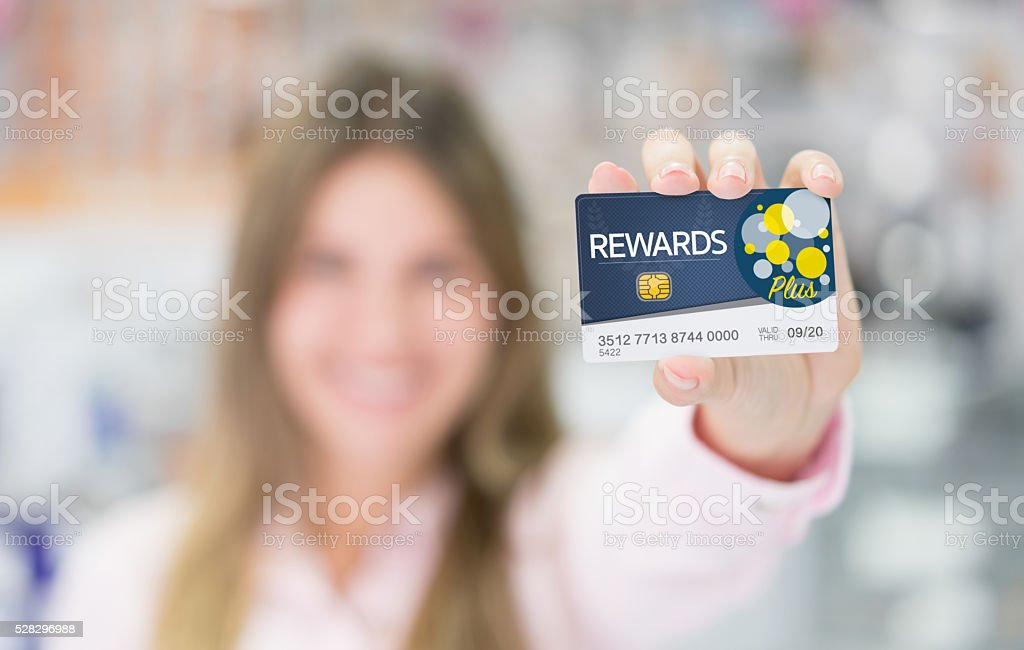 Woman holding a loyalty card stock photo
