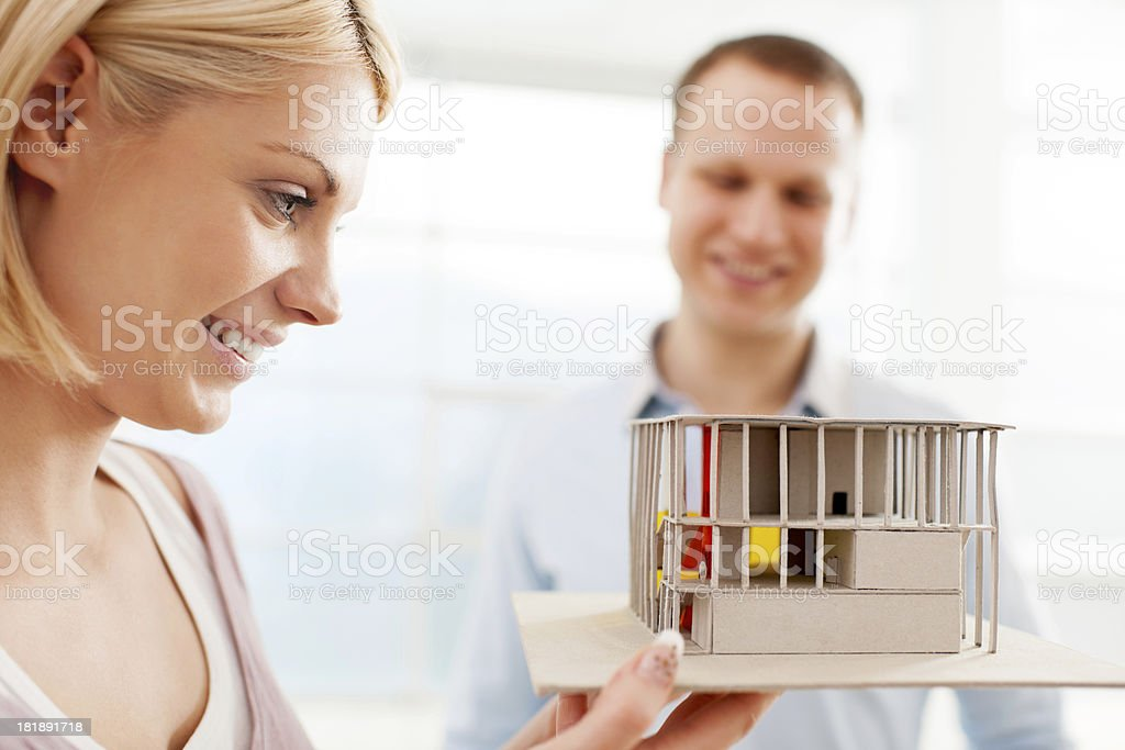 Woman holding a miniature model house royalty-free stock photo