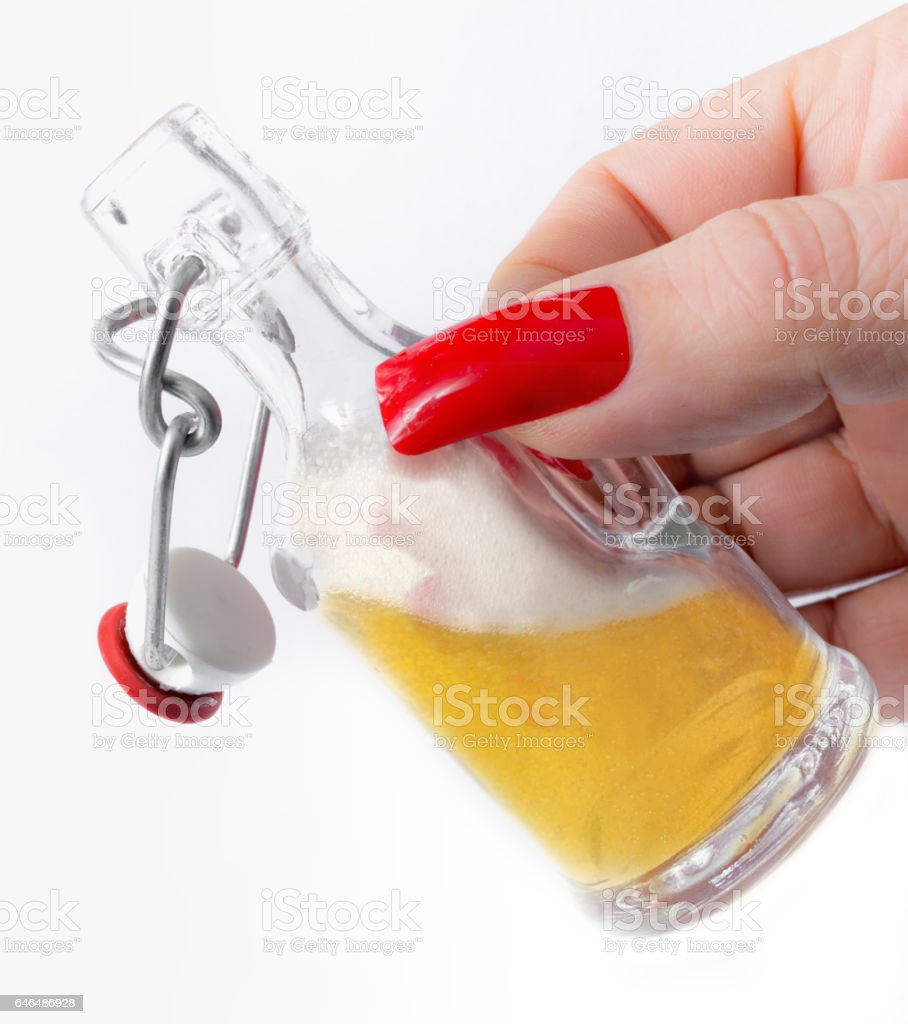Woman holding a miniature  swing-top stopper bottle with beer stock photo