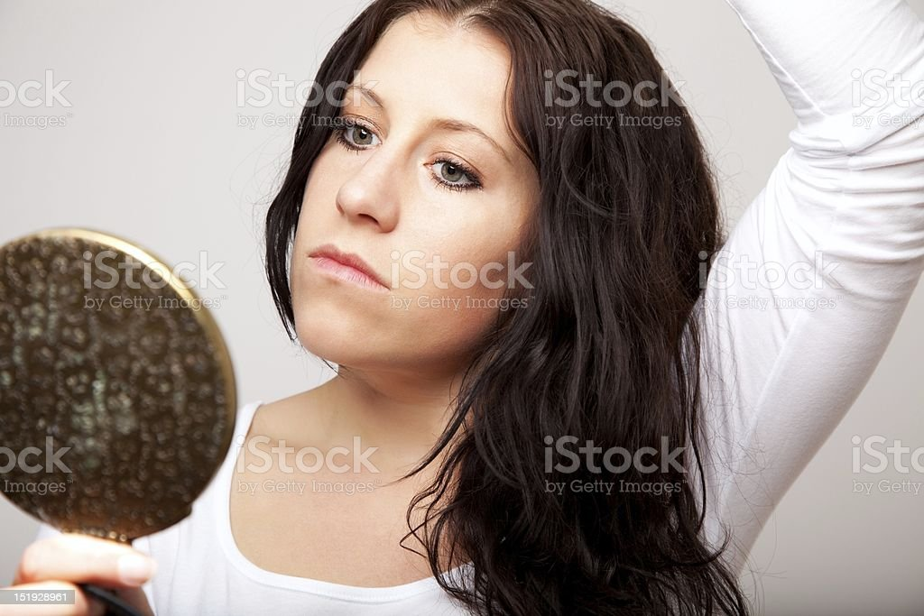 Woman Holding a Mirror stock photo