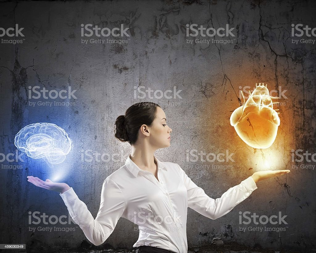 A woman holding a neon heart and brain stock photo