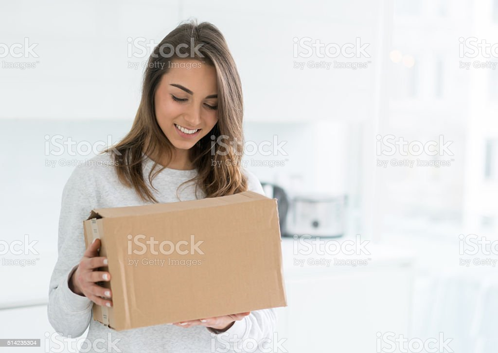 Woman holding a package stock photo