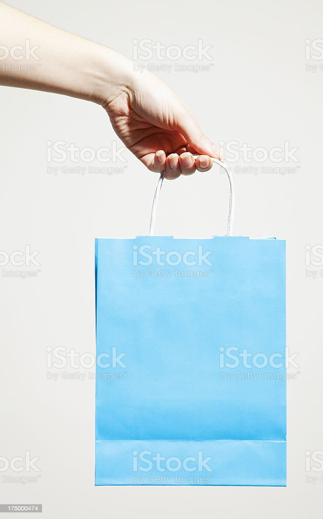 woman holding a paper bag royalty-free stock photo