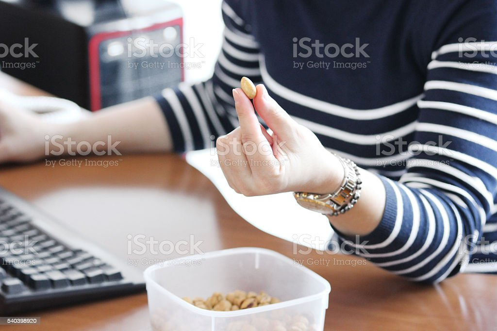 Woman holding a Peanut stock photo