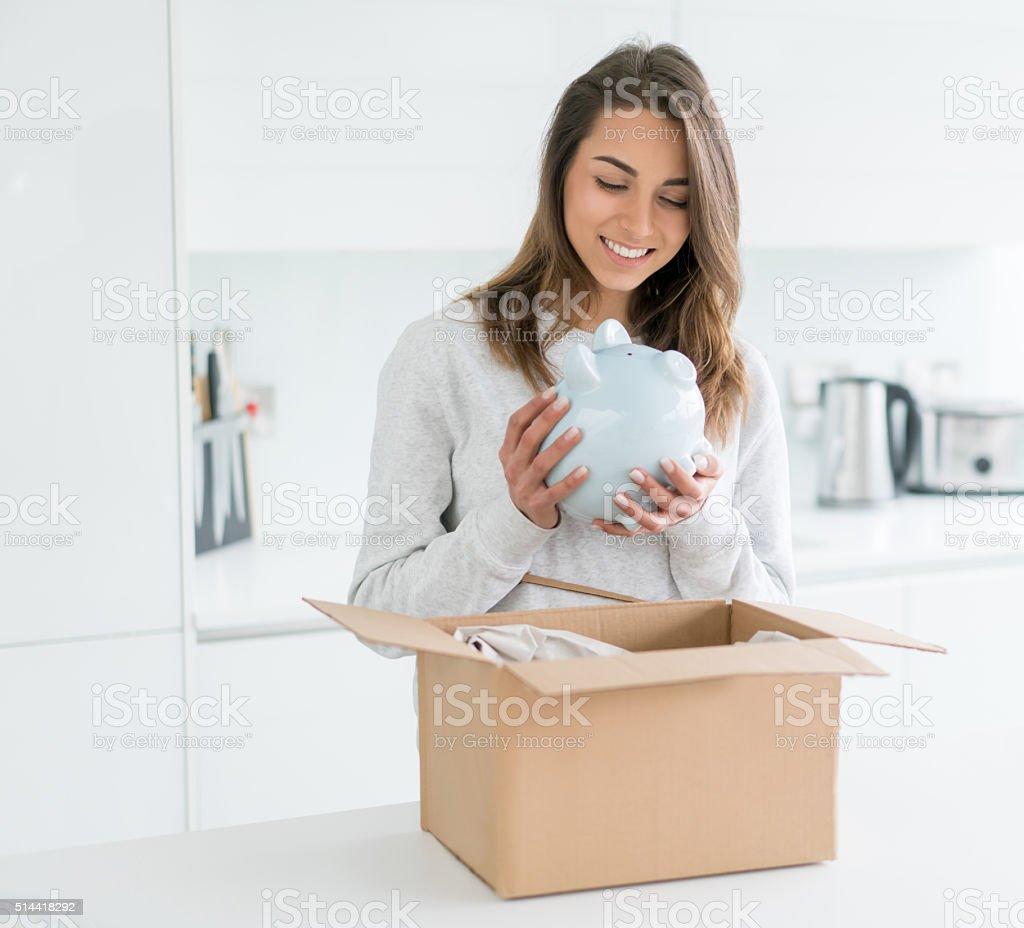 Woman holding a piggybank stock photo