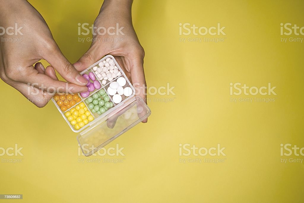 Woman holding a pillbox royalty-free stock photo