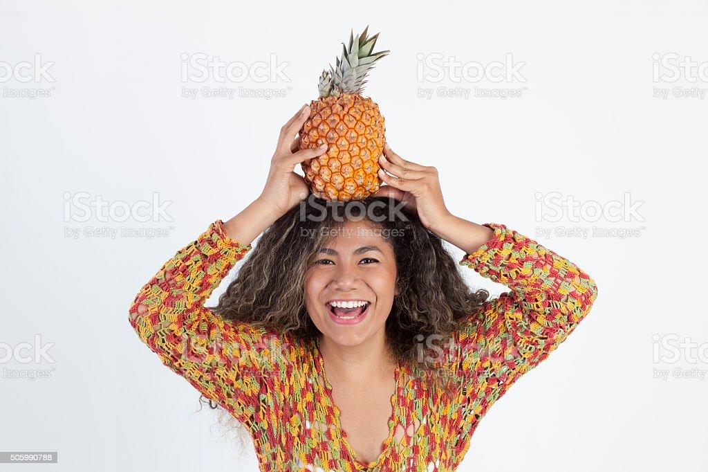 Woman holding a pinaple stock photo