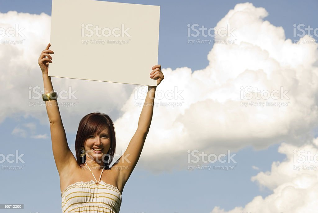 Woman holding a placard/sign royalty-free stock photo