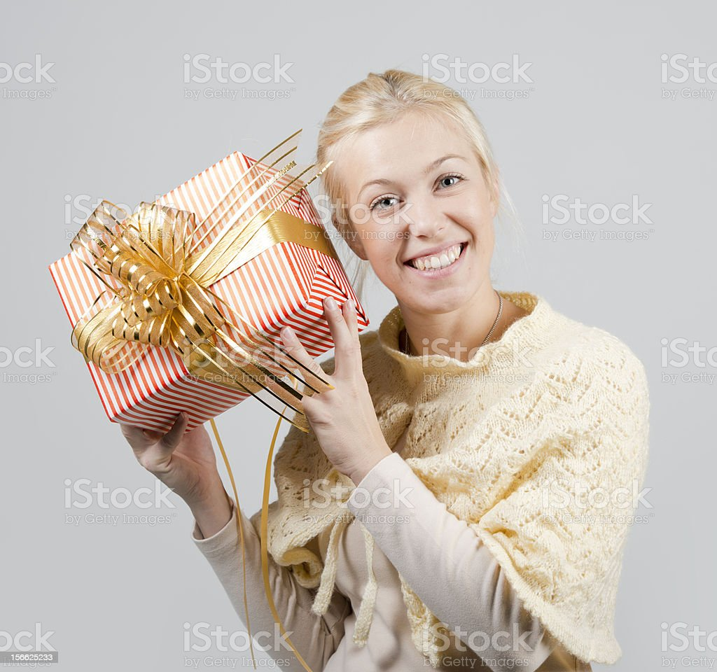 Woman holding a present royalty-free stock photo