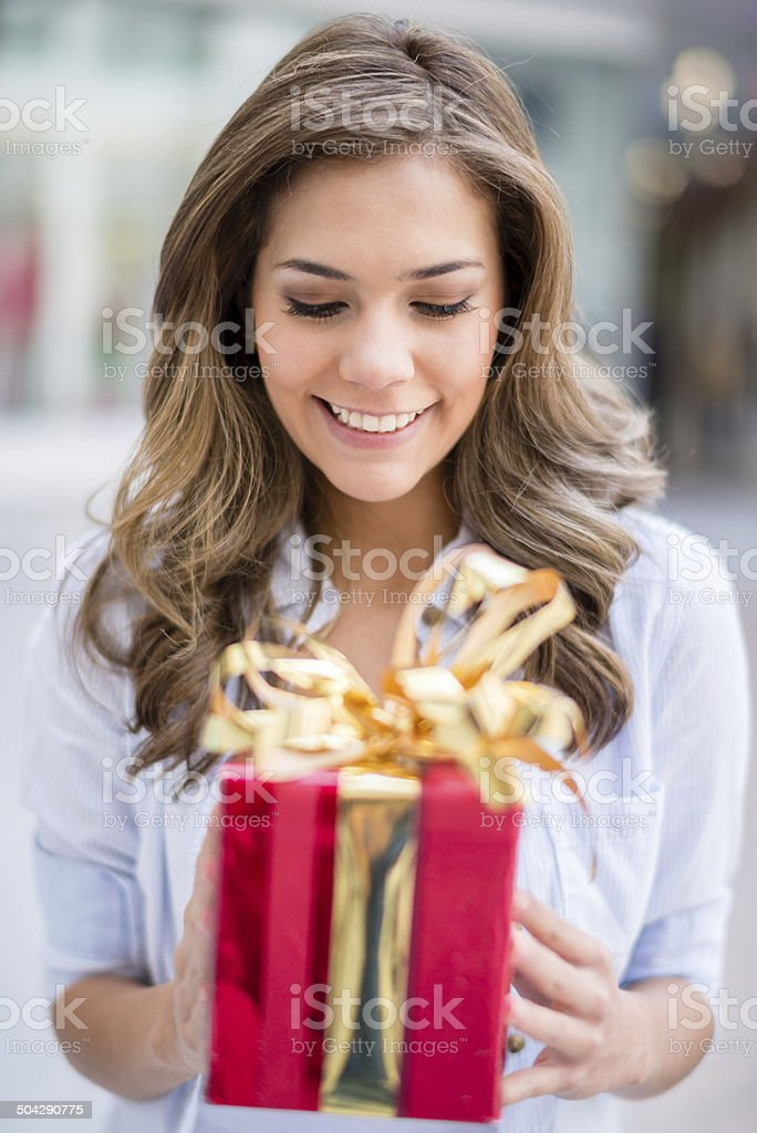 Woman holding a present stock photo