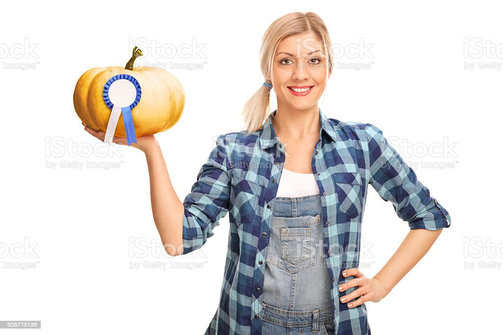 Woman holding a pumpkin with award stock photo
