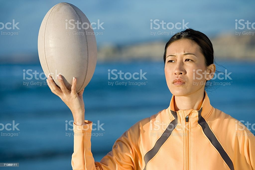 Woman holding a rugby ball stock photo