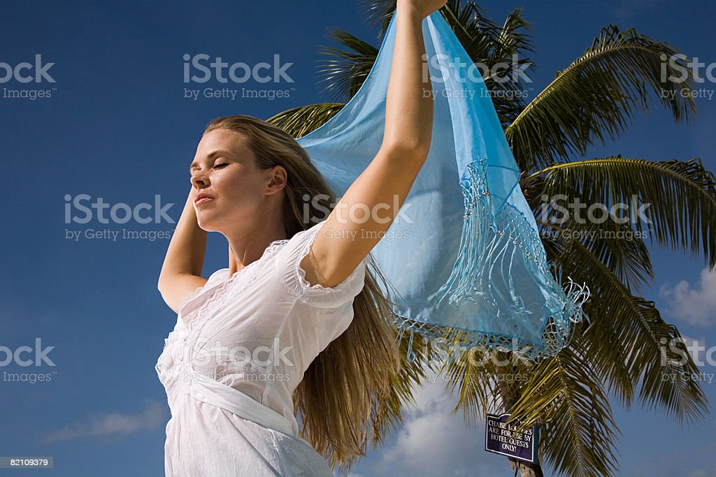 A woman holding a sarong royalty-free stock photo