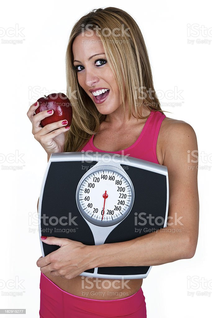 Woman holding a scale eating an apple royalty-free stock photo