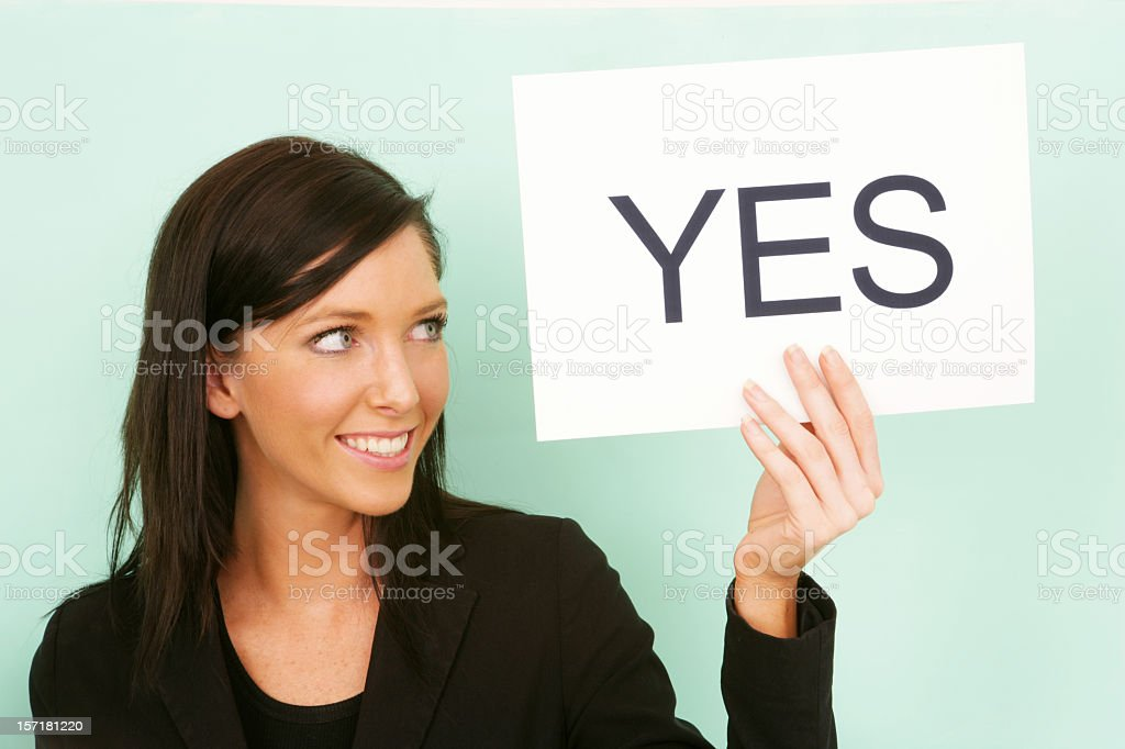 Woman holding a sign reading yes  stock photo