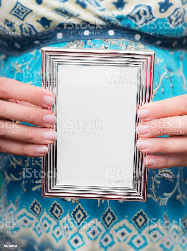 Woman holding a silver frame stock photo