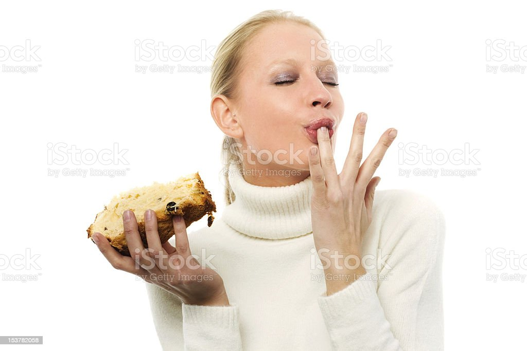 woman holding a slice of panettone cake stock photo