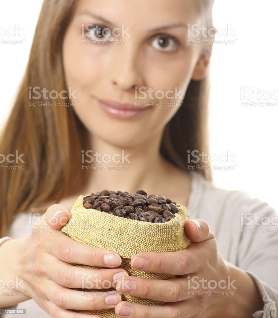 woman holding a small bag of coffee beans royalty-free stock photo