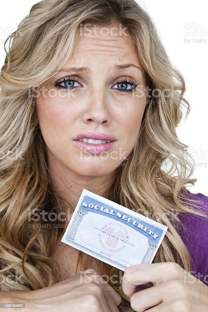Woman holding a social security card royalty-free stock photo