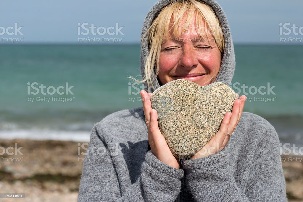 Woman holding a stone royalty-free stock photo