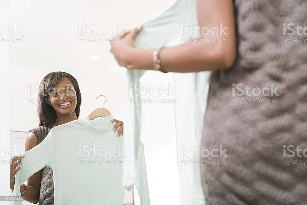 Woman holding a sweater stock photo
