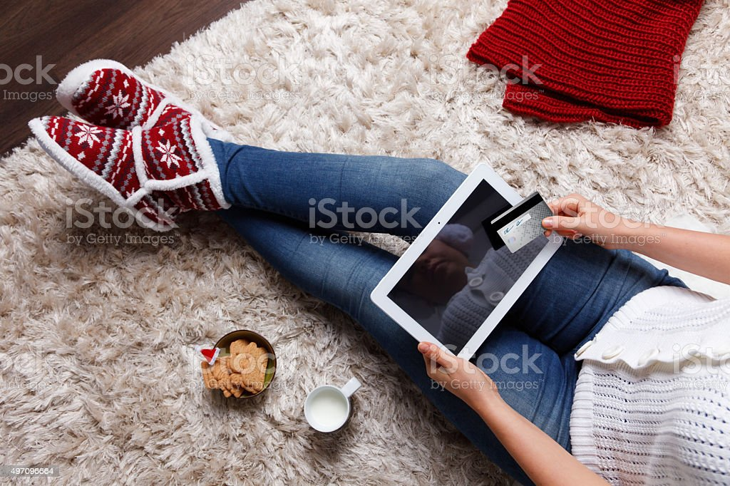 Woman holding a tablet and a credit card stock photo