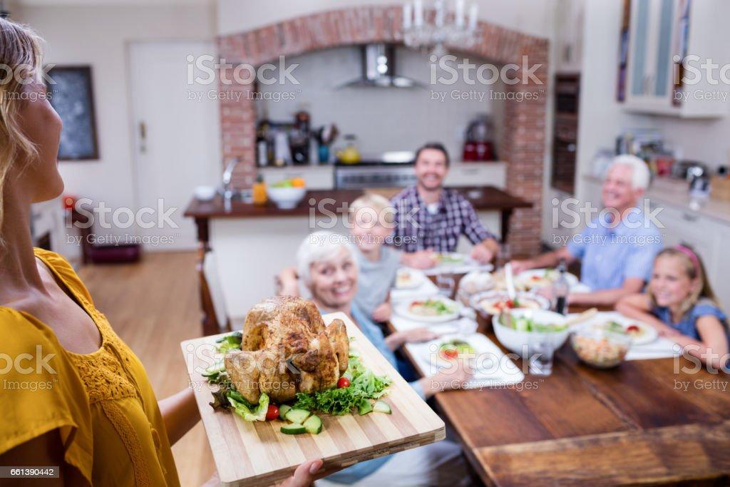 Woman holding a tray of roasted turkey stock photo
