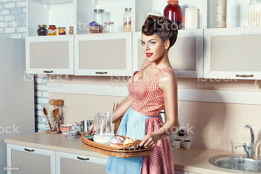 Woman holding a tray. stock photo