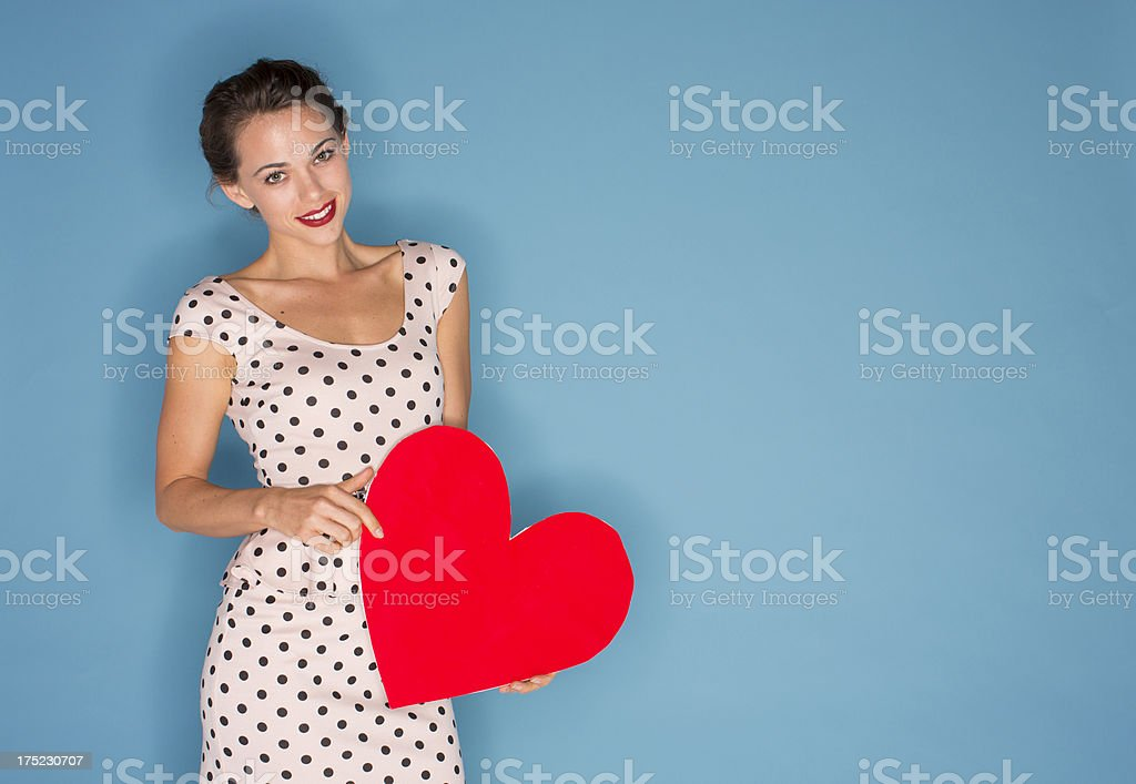 Woman holding a valentine stock photo