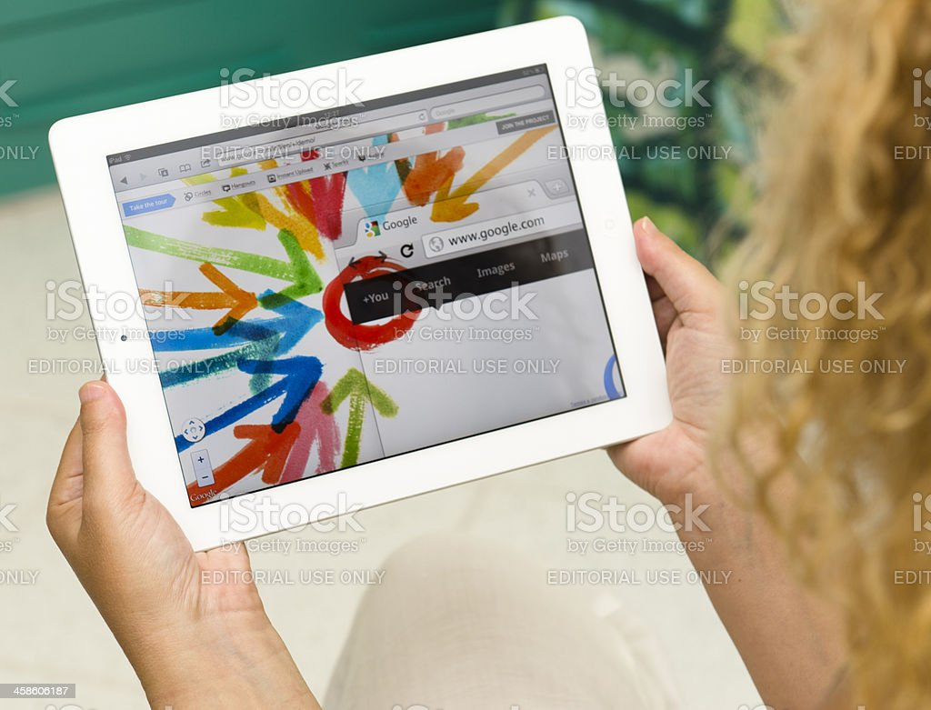 Woman holding a white iPad 2 with Google plus app stock photo