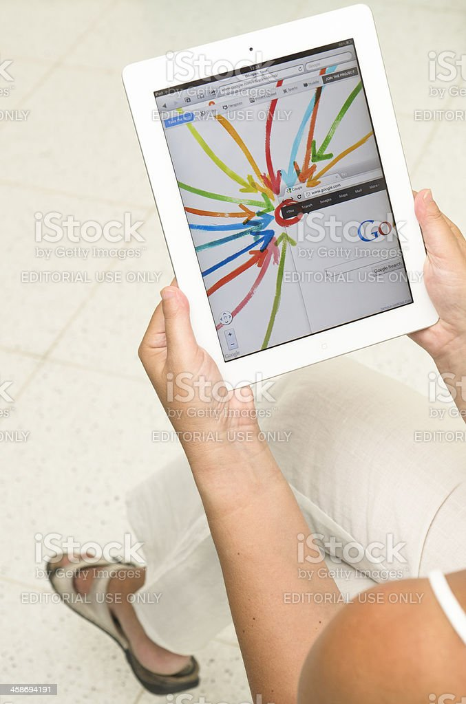 Woman holding a white iPad 2 with Google plus app royalty-free stock photo