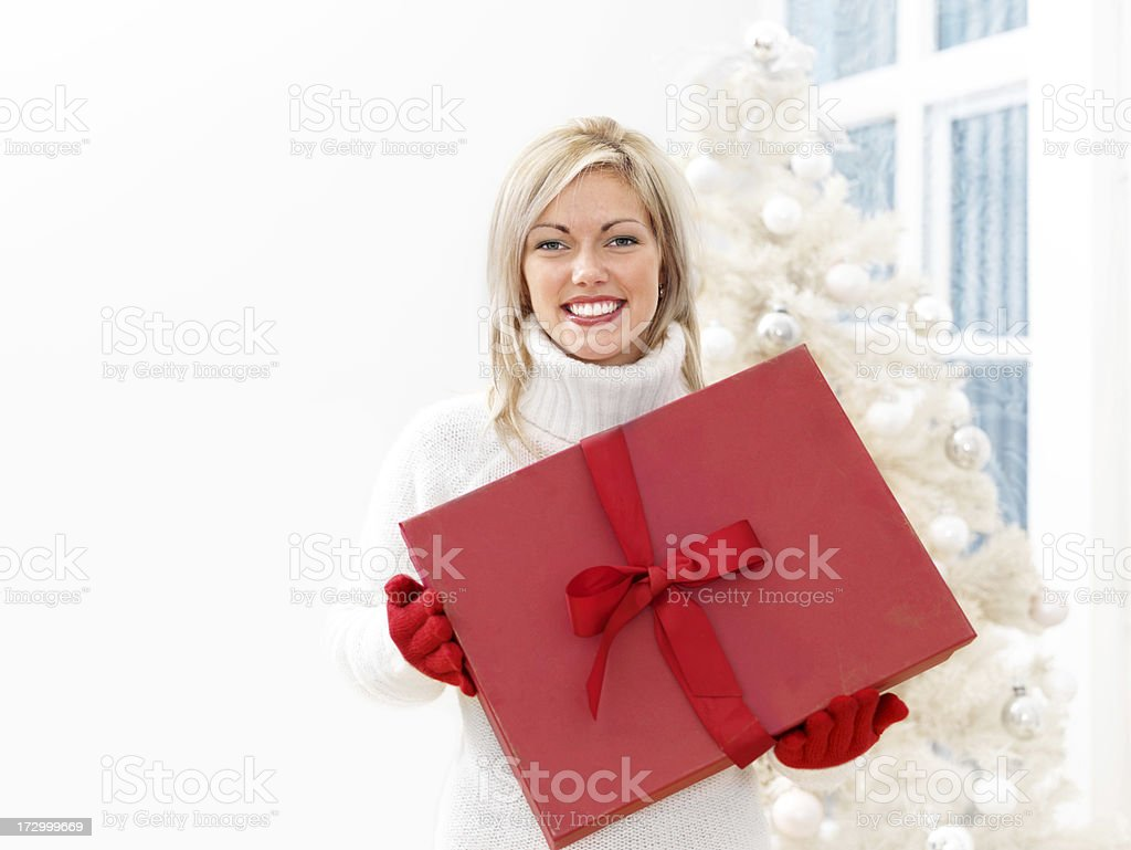 Woman holding a Xmas Present royalty-free stock photo