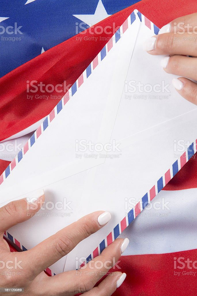 Woman Holding Air Mail Letter US Flag Behind royalty-free stock photo