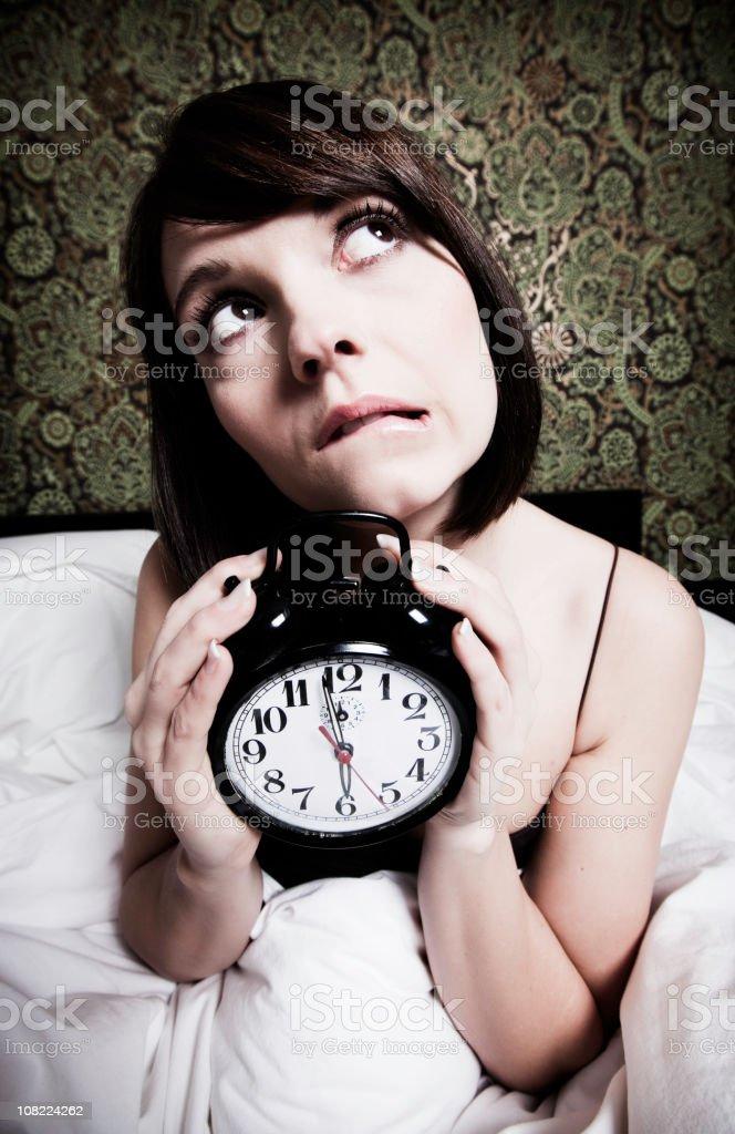 Woman Holding Alarm Clock royalty-free stock photo