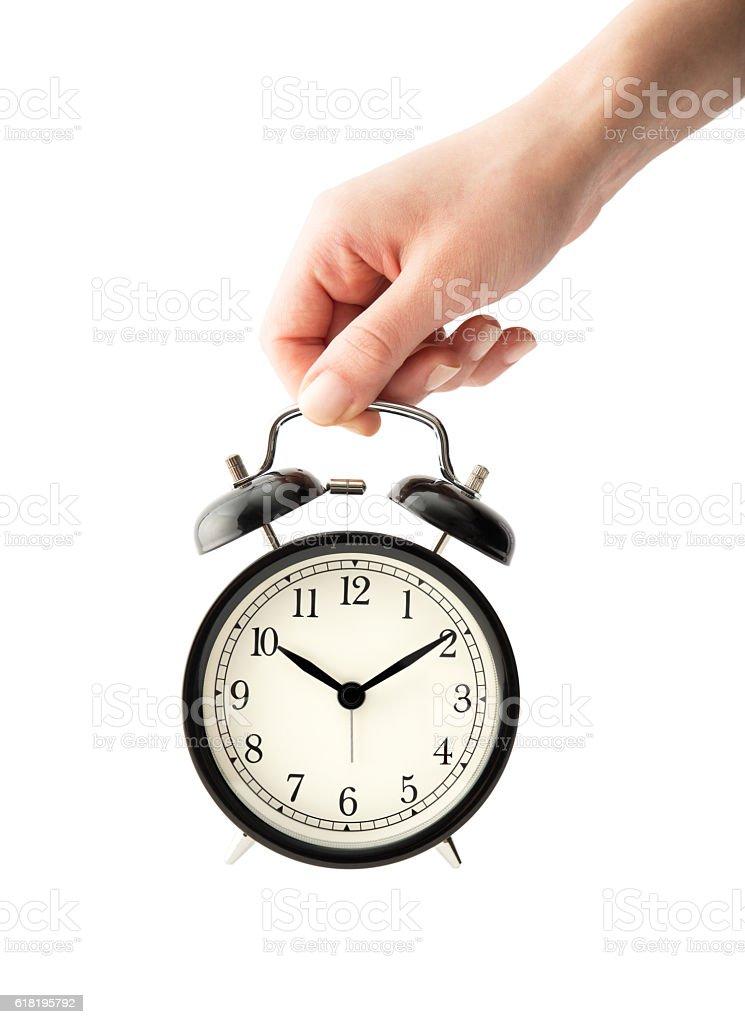 Woman holding an alarm clock stock photo