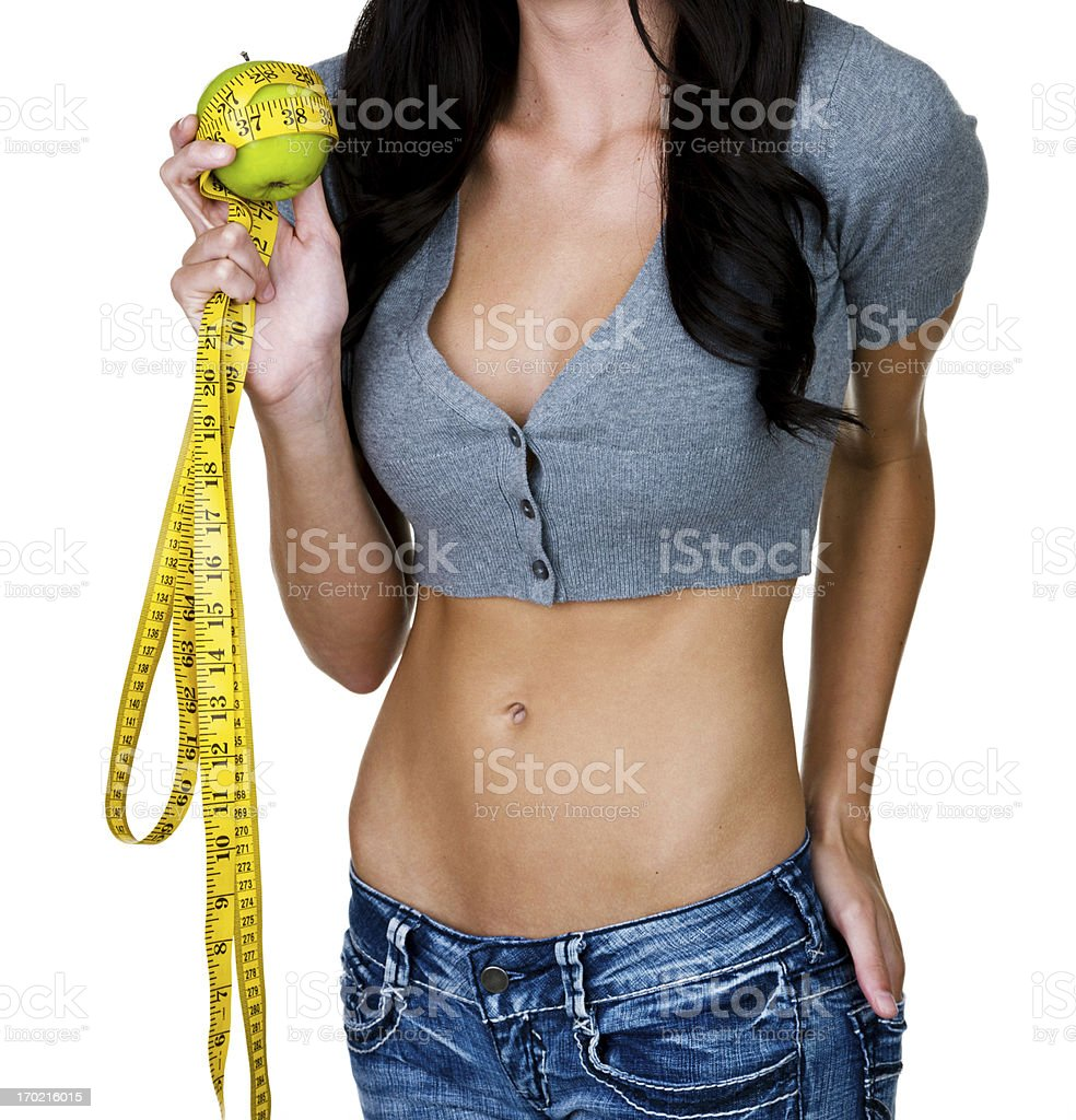 Woman holding an apple and measuring tape royalty-free stock photo