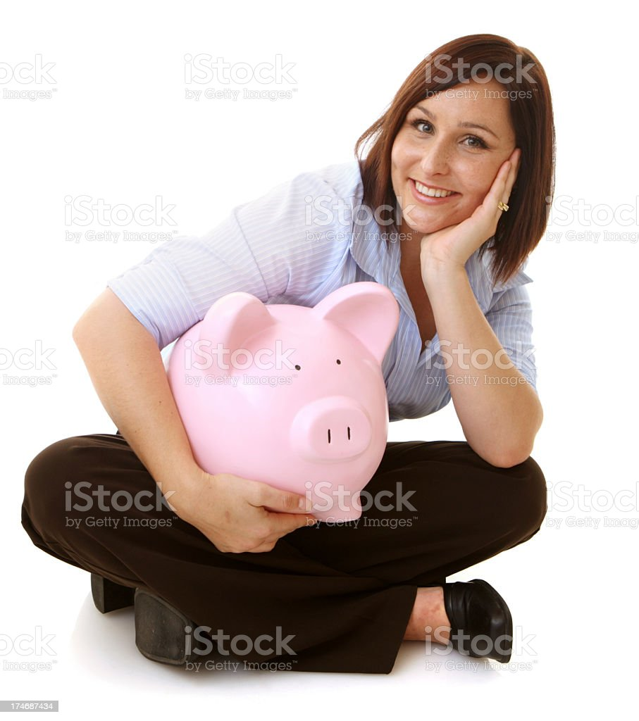 Woman holding an extra large pink piggy bank royalty-free stock photo