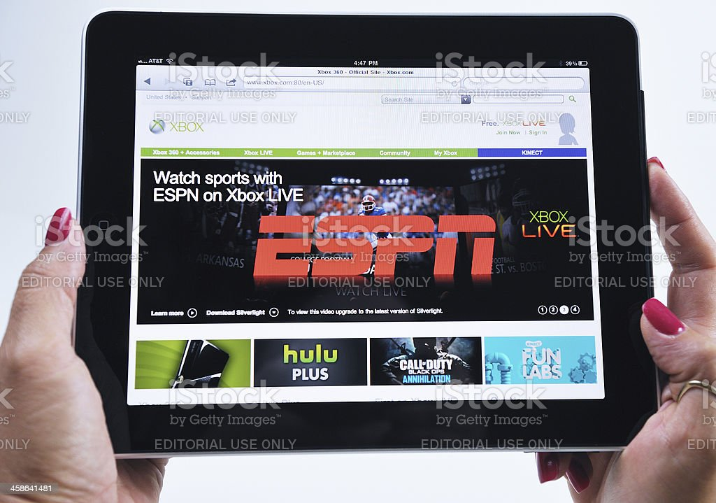Woman Holding an iPad Displaying ESPN Xbox Video Game royalty-free stock photo