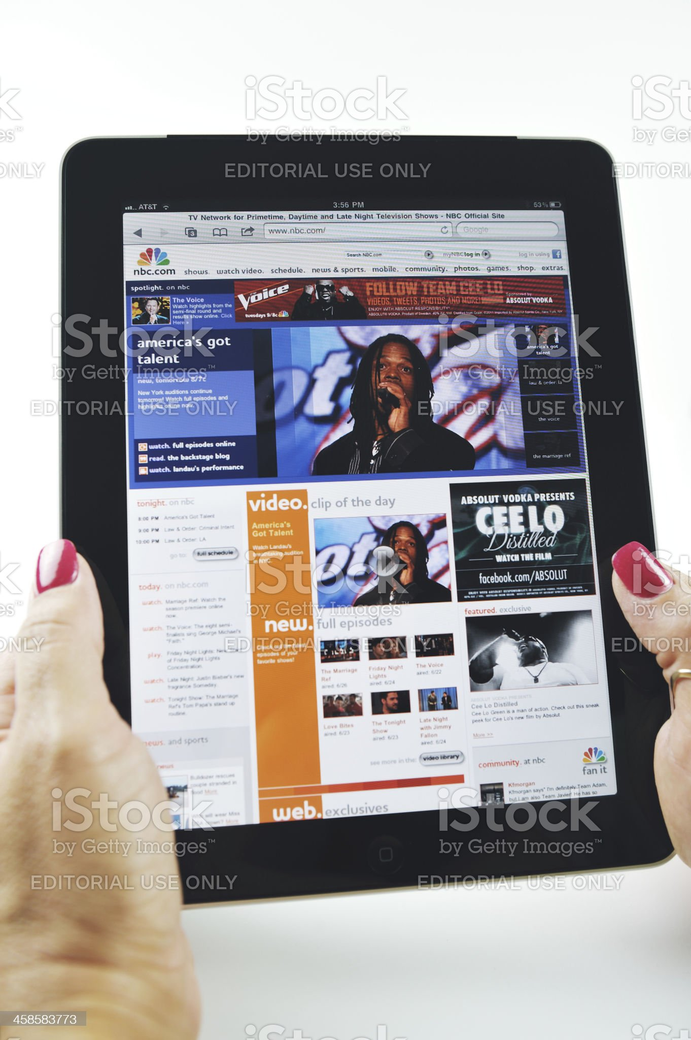 Woman Holding an iPad Displaying NBC Network Web Site. royalty-free stock photo